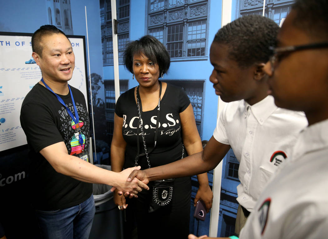Zappos CEO Tony Hsieh, left, meets Malik McHugh, 14, second from right, and Marshon Lee, 14, both eighth graders at Rainbow Dreams Academy, as organizer Duana Malone looks on during the first Dr. ...