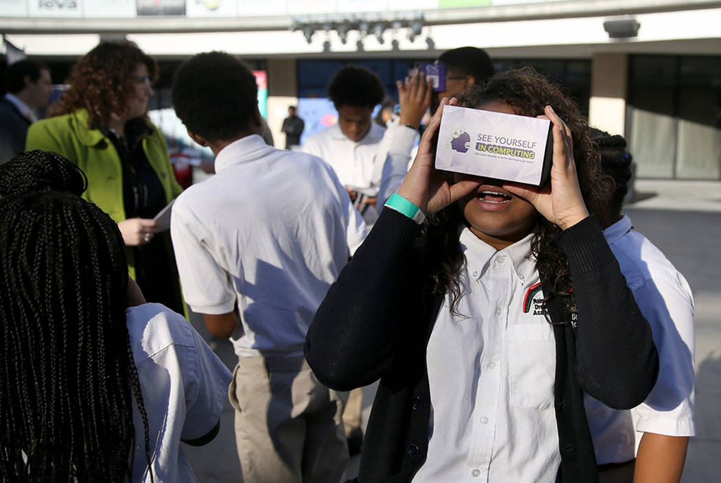 Rainbow Dreams Academy sixth-grader Delainey Hearon checks out virtual reality cardboard set using a smart phone during the the first Dr. Martin Luther King Jr. Technology Summit at Zappos headqua ...