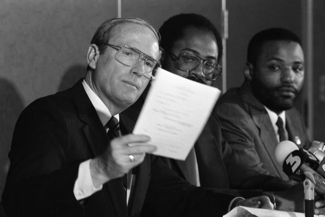 Governor Richard Bryan (left) at a press conference signing a bill which declares the third Monday in January a state holiday honoring slain civil rights leader Dr. Martin Luther King Jr. The sign ...