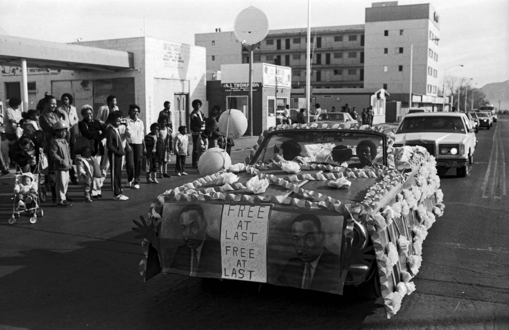Images from a parade on D Street organized by the Kappi xi chapter of Omega Psi Phi Fraternity to commemorate the birthday of Doctor Martin Luther King on Jan. 16, 1982. Photograph by Scott Henry