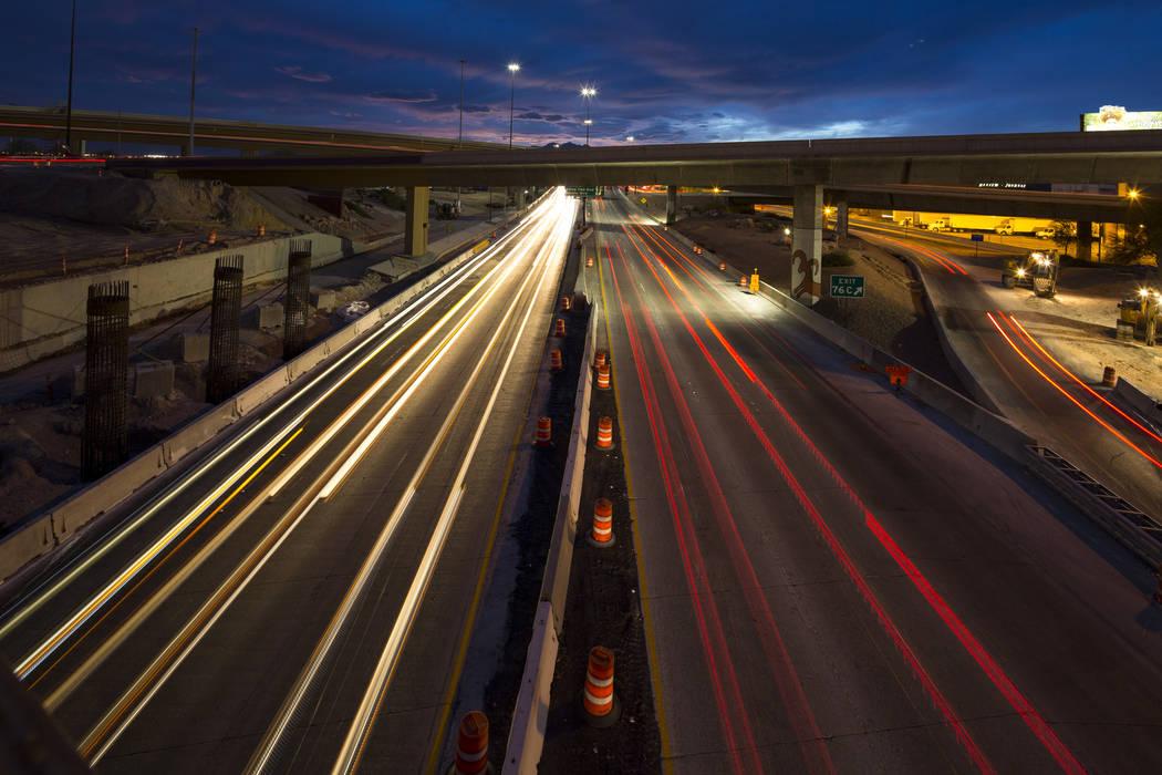 Vehicles travel along U.S. Highway 95 through the Spaghetti Bowl freeway interchange near downtown Las Vegas on Friday, April 6, 2018. Richard Brian Las Vegas Review-Journal @vegasphotograph