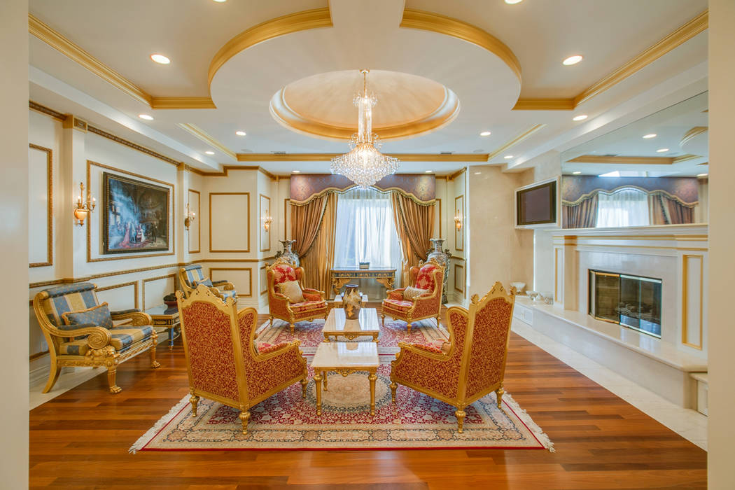 The interior of the mansion at 9009 Greensboro Lane in Las Vegas is seen above. The home was formerly owned by Edwin Fujinaga, who was convicted in November of running a $1.5 billion Ponzi scheme. ...
