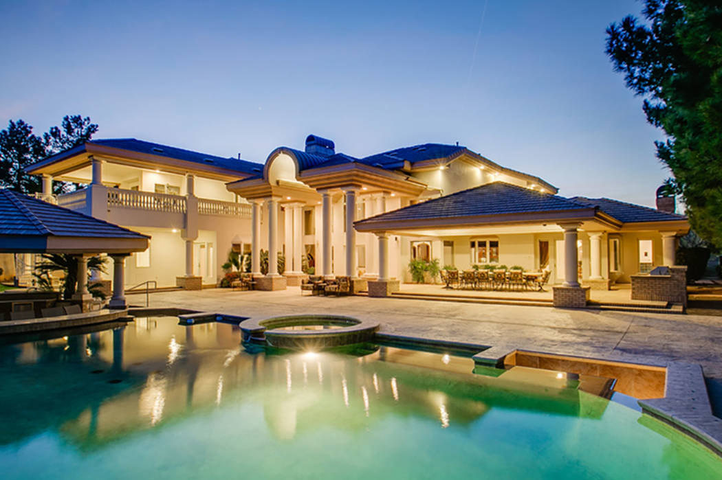 The backyard of the mansion at 9009 Greensboro Lane in Las Vegas is seen above. The home was formerly owned by Edwin Fujinaga, who was convicted in November of running a $1.5 billion Ponzi scheme. ...