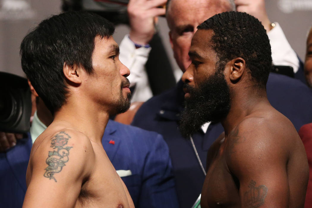Manny Pacquiao, left, and Adrien Broner pose during their weigh-in event at the MGM Grand Garden Arena in Las Vegas, Friday, Jan. 18, 2019. Erik Verduzco Las Vegas Review-Journal @Erik_Verduzco