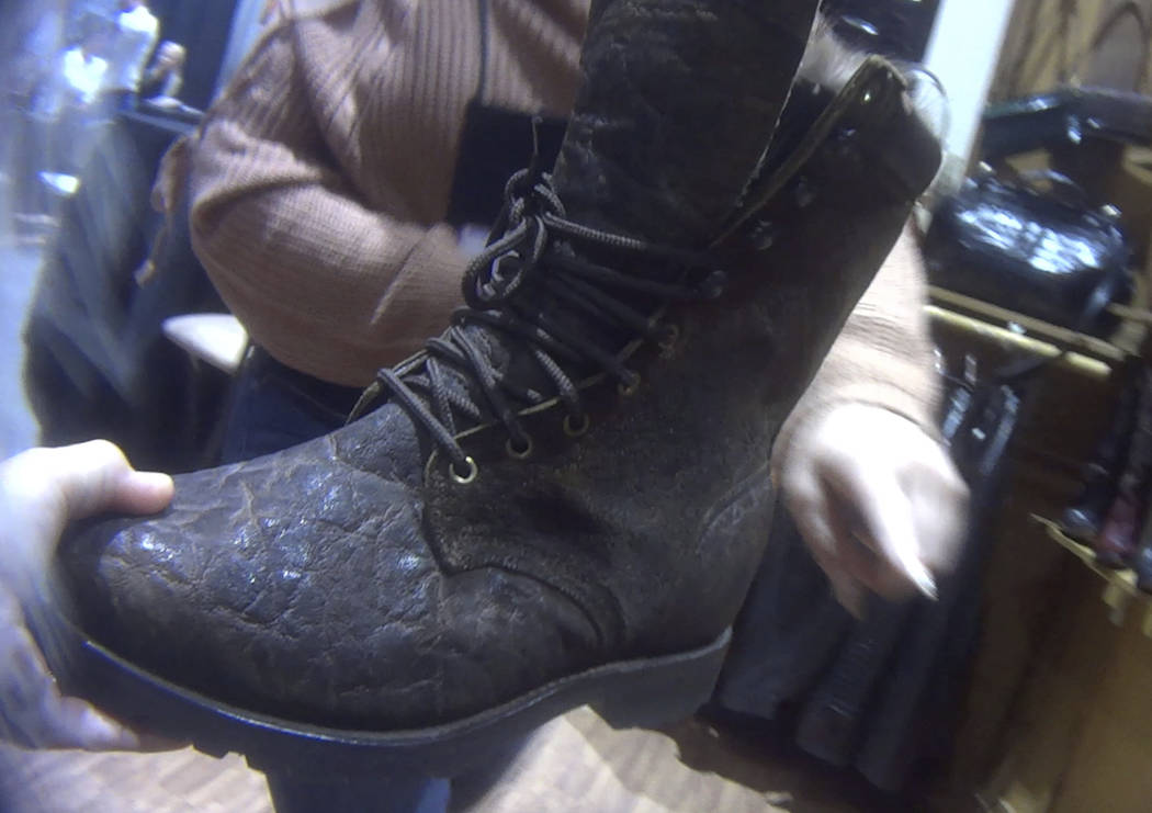 In this image, a hunting boot, labeled that it was made from elephant hide, is displayed at the Safari Club International conference in Reno on Jan. 9, 2019. (Humane Society of the United States v ...