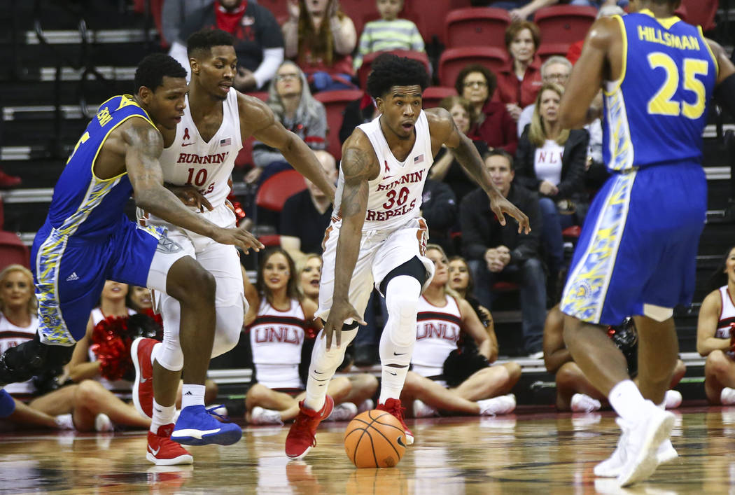 UNLV Rebels guard Jovan Mooring (30) drives against San Jose State during a basketball game at the Thomas & Mack Center in Las Vegas on Wednesday, Jan. 31, 2018. (Chase Stevens/Las Vegas Review-Jo ...