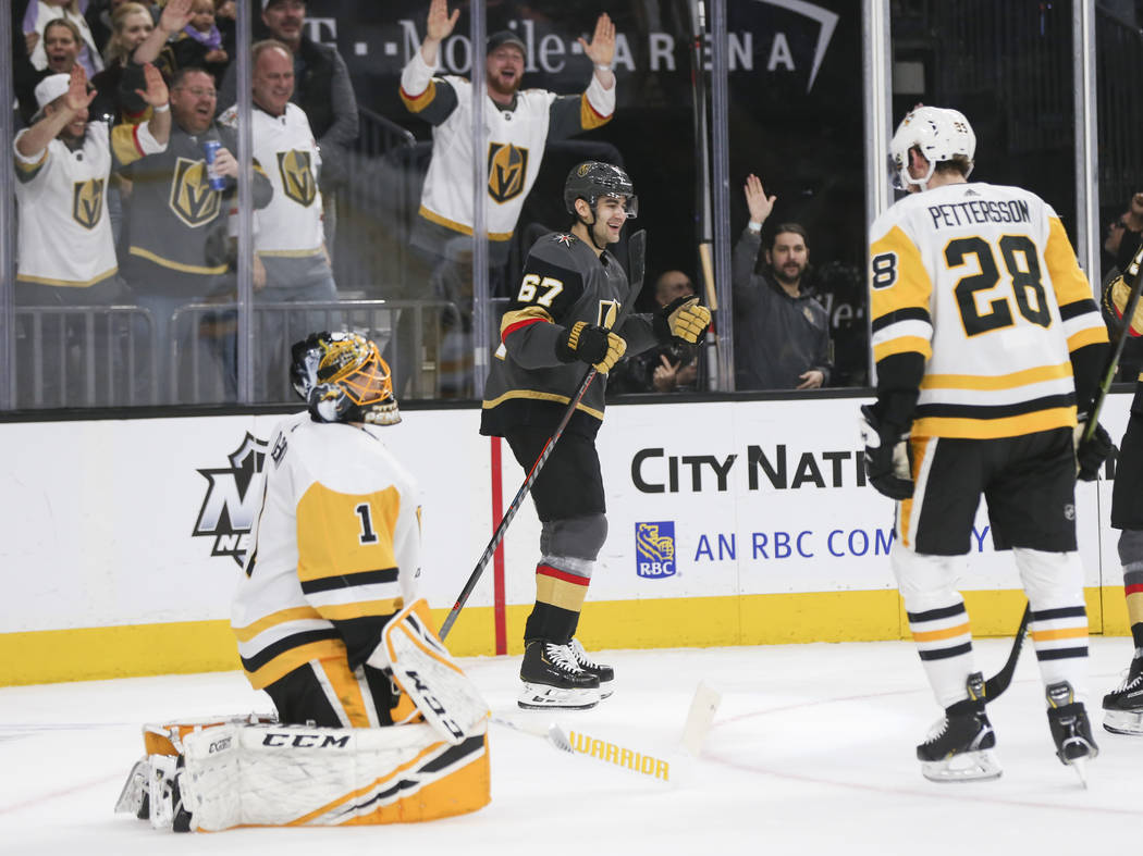 Golden Knights left wing Max Pacioretty (67) celebrates his goal against Pittsburgh Penguins goaltender Casey DeSmith (1) during the first period of an NHL hockey game at T-Mobile Arena in Las Veg ...