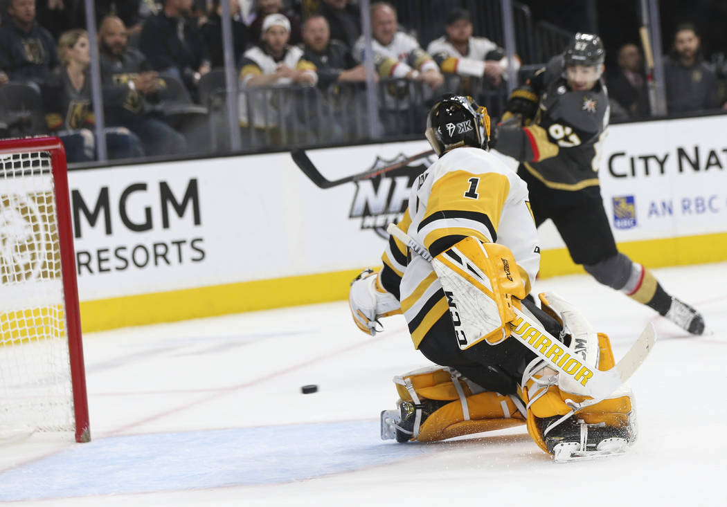Pittsburgh Penguins goaltender Casey DeSmith (1) gives up a goal to Golden Knights left wing Max Pacioretty, background right, during the first period of an NHL hockey game at T-Mobile Arena in La ...