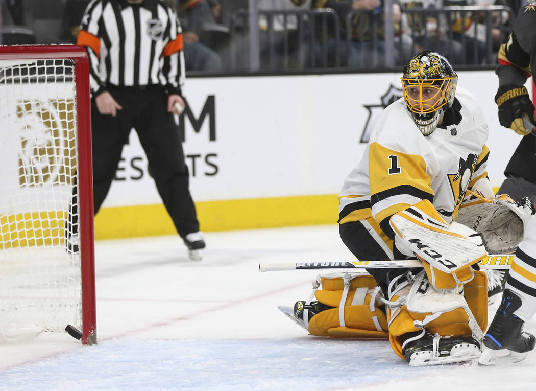 Golden Knights defenseman Shea Theodore, not pictured, scores a goal past Pittsburgh Penguins goaltender Casey DeSmith (1) during the first period of an NHL hockey game at T-Mobile Arena in Las Ve ...