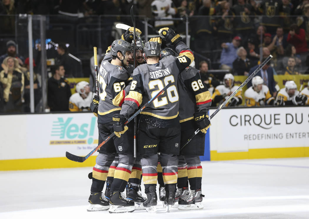 Golden Knights players celebrate a goal by defenseman Shea Theodore during the first period of an NHL hockey game against the Pittsburgh Penguins at T-Mobile Arena in Las Vegas on Saturday, Jan. 1 ...