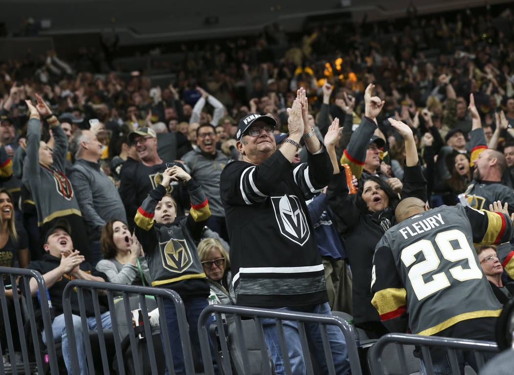 Golden Knights fans celebrate a goal by Golden Knights center Jonathan Marchessault during the second period of an NHL hockey game at T-Mobile Arena in Las Vegas on Saturday, Jan. 19, 2019. Chase ...