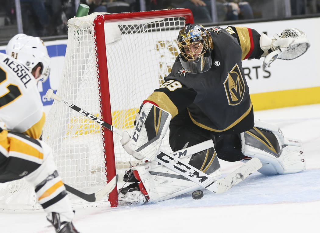 Golden Knights goaltender Marc-Andre Fleury (29) blocks a shot from Pittsburgh Penguins right wing Phil Kessel during the second period of an NHL hockey game at T-Mobile Arena in Las Vegas on Satu ...