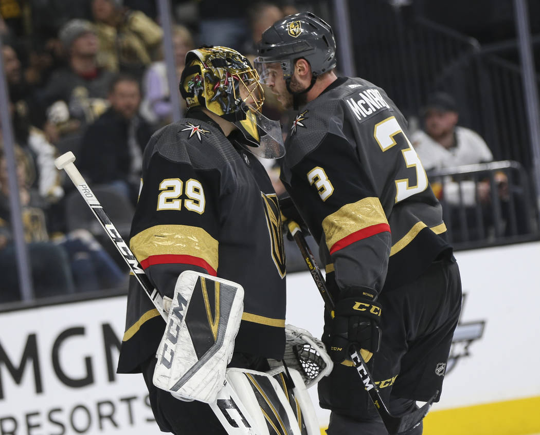 Golden Knights goaltender Marc-Andre Fleury (29) talks with defenseman Brayden McNabb (3) during the second period of an NHL hockey game against the Pittsburgh Penguins at T-Mobile Arena in Las Ve ...