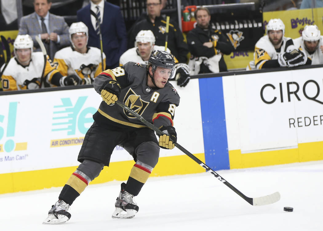 Golden Knights defenseman Nate Schmidt (88) moves the puck against the Pittsburgh Penguins during the first period of an NHL hockey game at T-Mobile Arena in Las Vegas on Saturday, Jan. 19, 2019. ...
