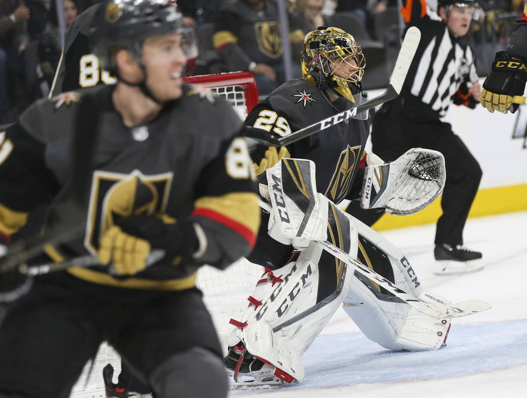 Golden Knights goaltender Marc-Andre Fleury (29) defends the net during the second period of an NHL hockey game against the Pittsburgh Penguins at T-Mobile Arena in Las Vegas on Saturday, Jan. 19, ...