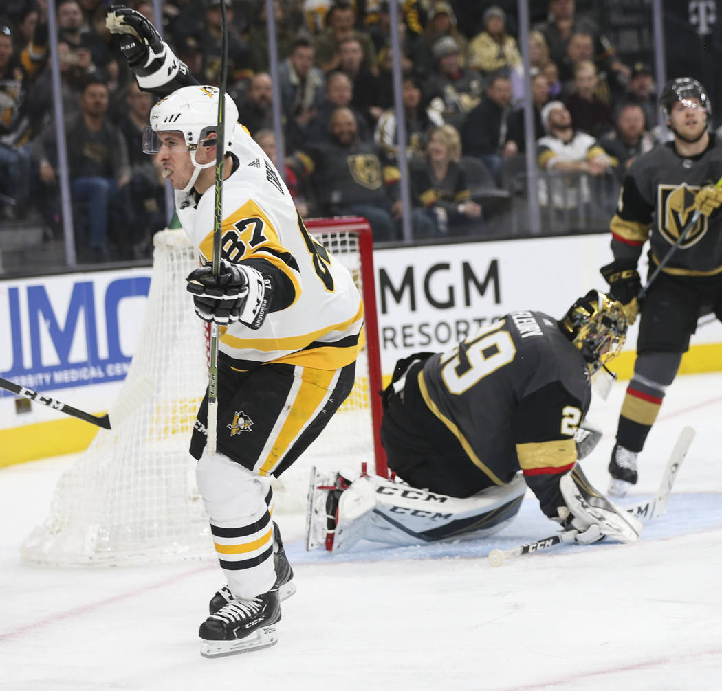Pittsburgh Penguins center Sidney Crosby (87) celebrates his goal past Golden Knights goaltender Marc-Andre Fleury (29) during the second period of an NHL hockey game at T-Mobile Arena in Las Vega ...