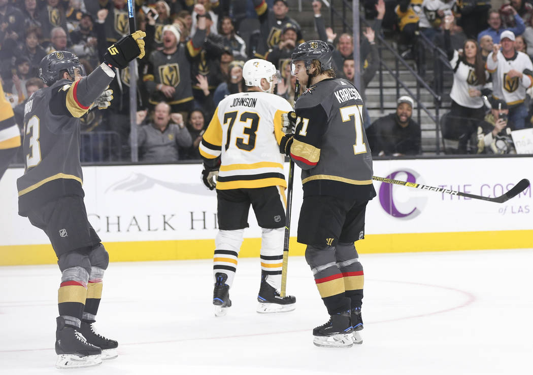 Golden Knights center Brandon Pirri, left, celebrates a goal by Golden Knights center William Karlsson (71) during the third period of an NHL hockey game against the Pittsburgh Penguins at T-Mobil ...