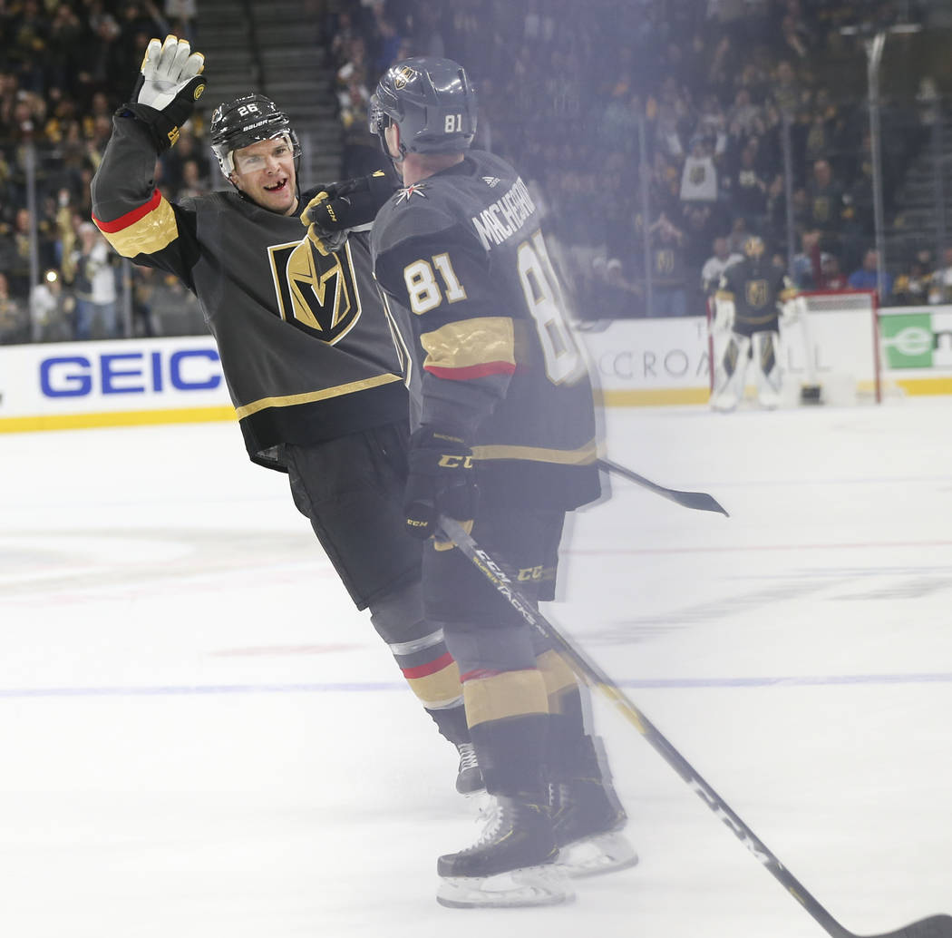Golden Knights center Paul Stastny, left, celebrates a goal by Golden Knights center Jonathan Marchessault, right, during the third period of an NHL hockey game at T-Mobile Arena in Las Vegas on S ...