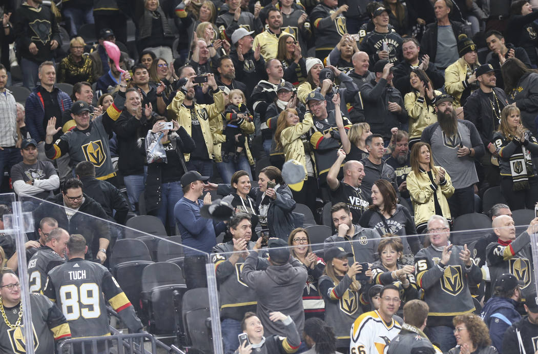 Golden Knights fans throw their hats onto the ice in celebration of a hat trick by Jonathan Marchessault, not pictured, during the third period of an NHL hockey game against the Pittsburgh Penguin ...