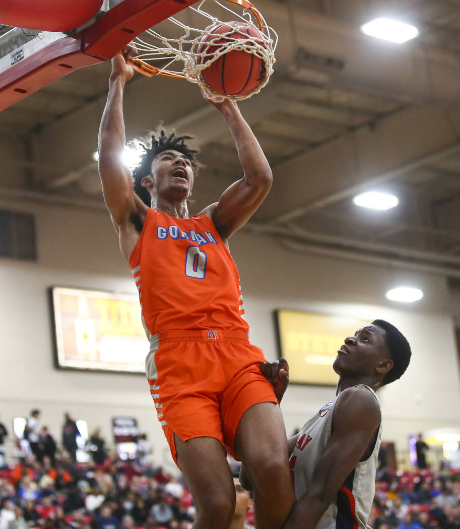 Bishop Gorman's Isaiah Cottrell (0) dunks over Findlay Prep's Alex Tchikou during the first half of the annual Big City Showdown basketball game at the South Point in Las Vegas on Saturday, Jan. 1 ...