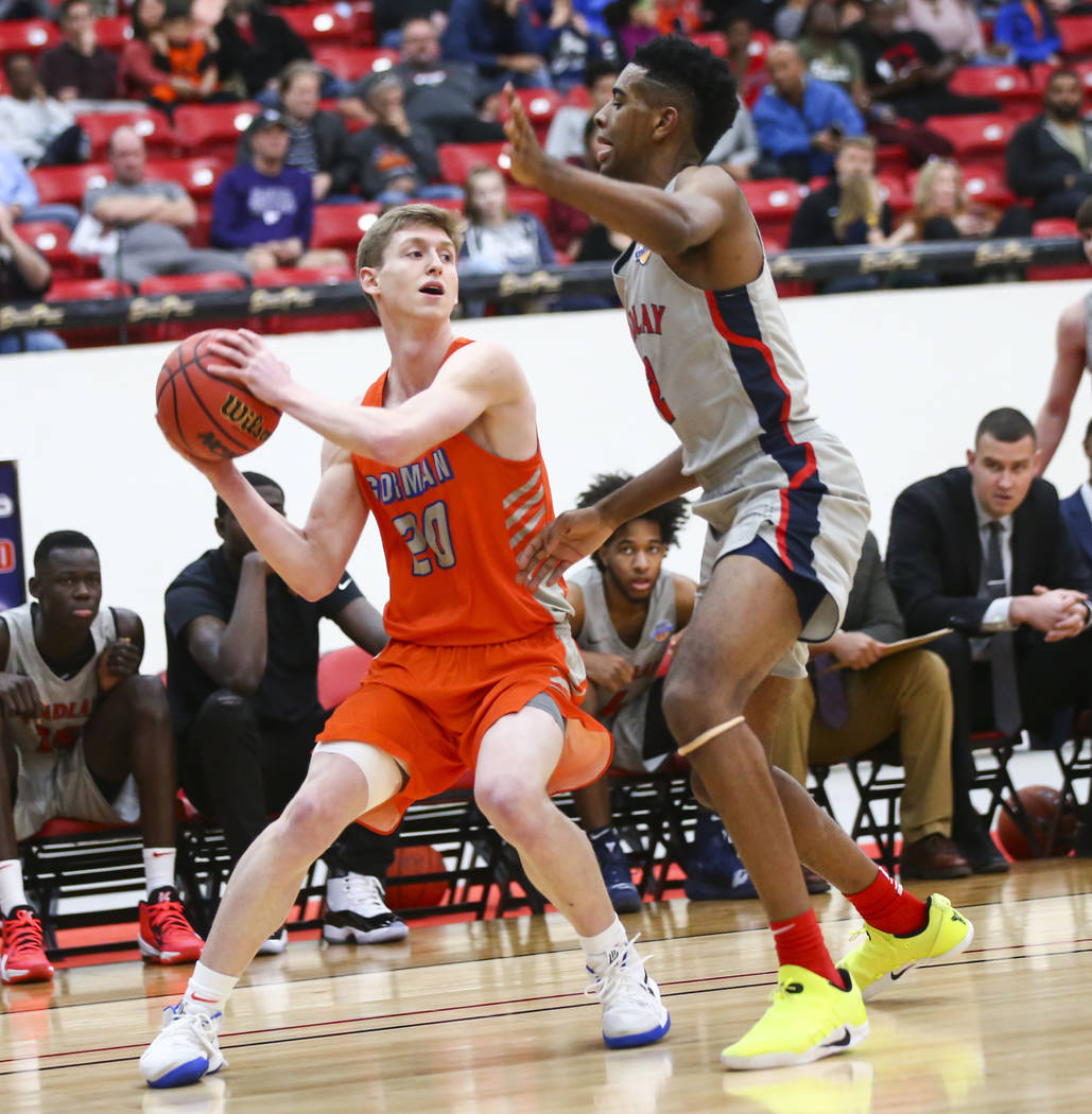 Bishop Gorman's Noah Taitz (20) tries to get the ball around Findlay Prep's Aston Smith during the first half of the annual Big City Showdown basketball game at the South Point in Las Vegas on Sat ...
