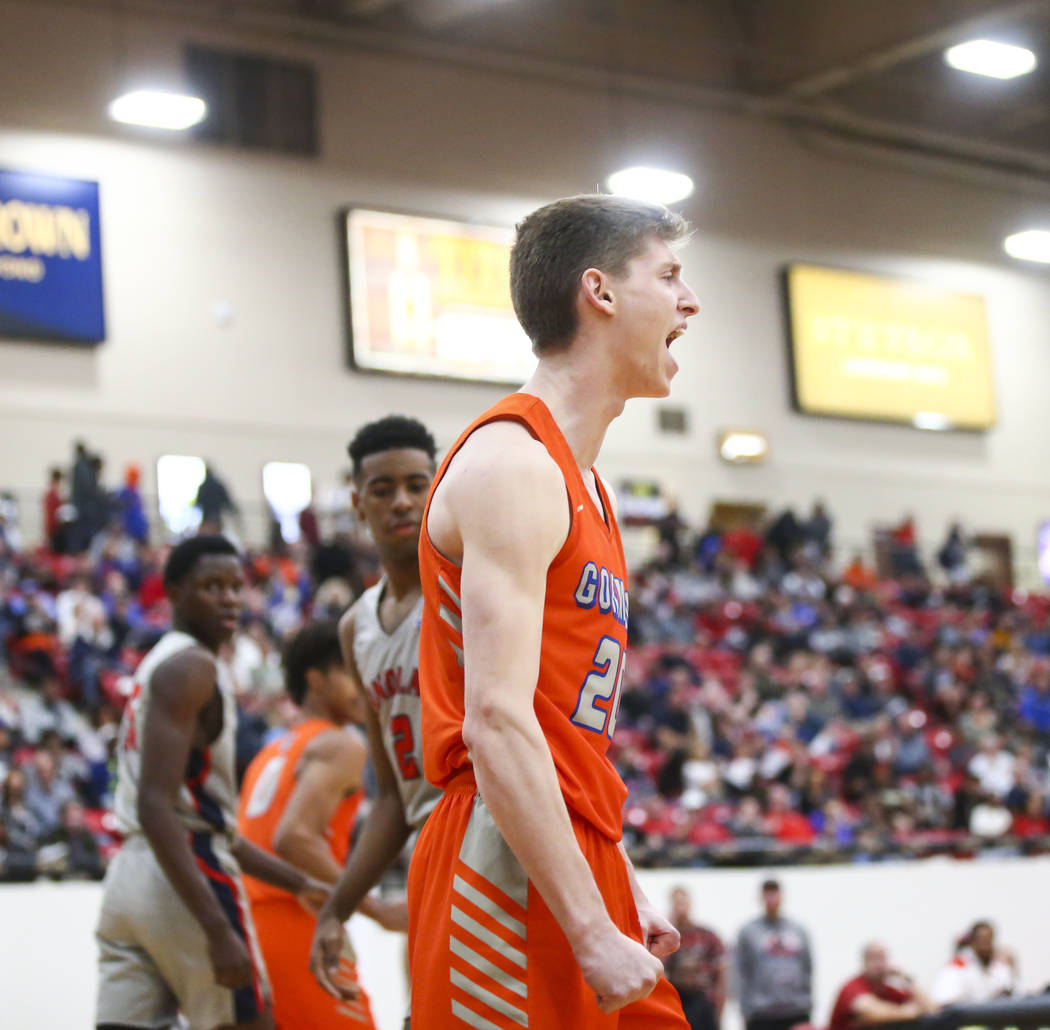 Bishop Gorman's Noah Taitz celebrates his dunk against Findlay Prep during the first half of the annual Big City Showdown basketball game at the South Point in Las Vegas on Saturday, Jan. 19, 2019 ...