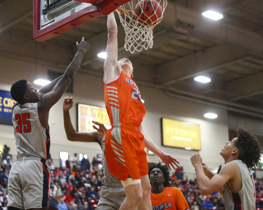 Bishop Gorman's Noah Taitz dunks in front of Findlay Prep's Alex Tchikou (35) during the first half of the annual Big City Showdown basketball game at the South Point in Las Vegas on Saturday, Jan ...