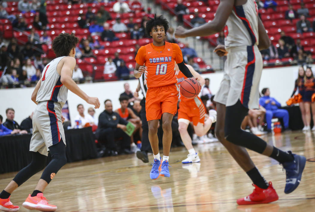 Bishop Gorman's Zaon Collins (10) brings the ball up court during the first half of the annual Big City Showdown basketball game against Findlay Prep at the South Point in Las Vegas on Saturday, J ...