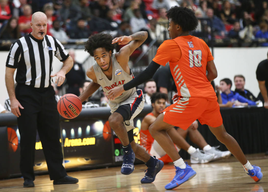 Findlay Prep's P.J. Fuller drives the ball against Bishop Gorman's Zaon Collins (10) during the second half of the annual Big City Showdown basketball game at the South Point in Las Vegas on Satur ...