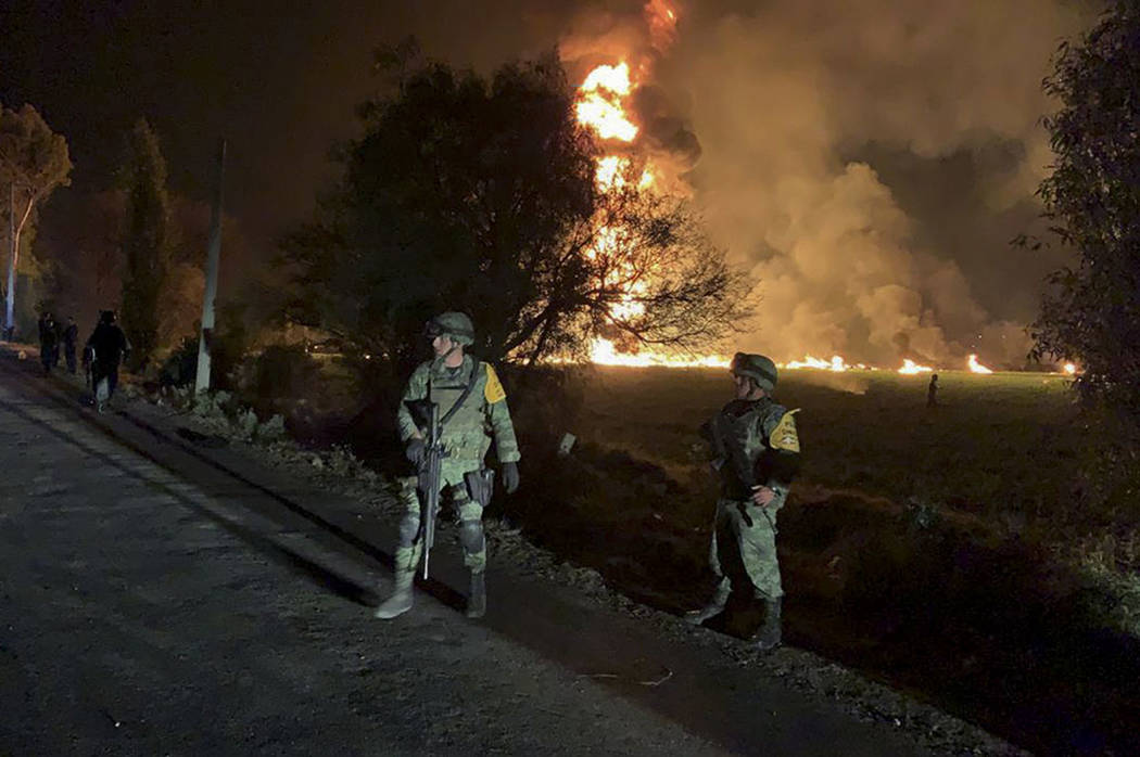 In this image provided by the Secretary of National Defense, soldiers guard in the area near an oil pipeline explosion in Tlahuelilpan, Hidalgo state, Mexico, Friday, Jan. 18, 2019. (Secretary of ...