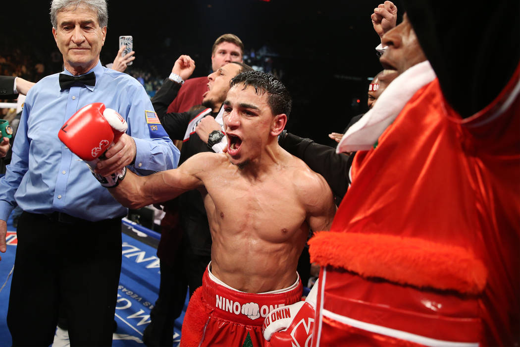 Nordine Oubaali celebrates his unanimous decision win against Rau'shee Warren in the WBC Bantamweight title bout at the MGM Grand Garden Arena in , Saturday, Jan. 19, 2019. (Erik Verduzco/Las Vega ...