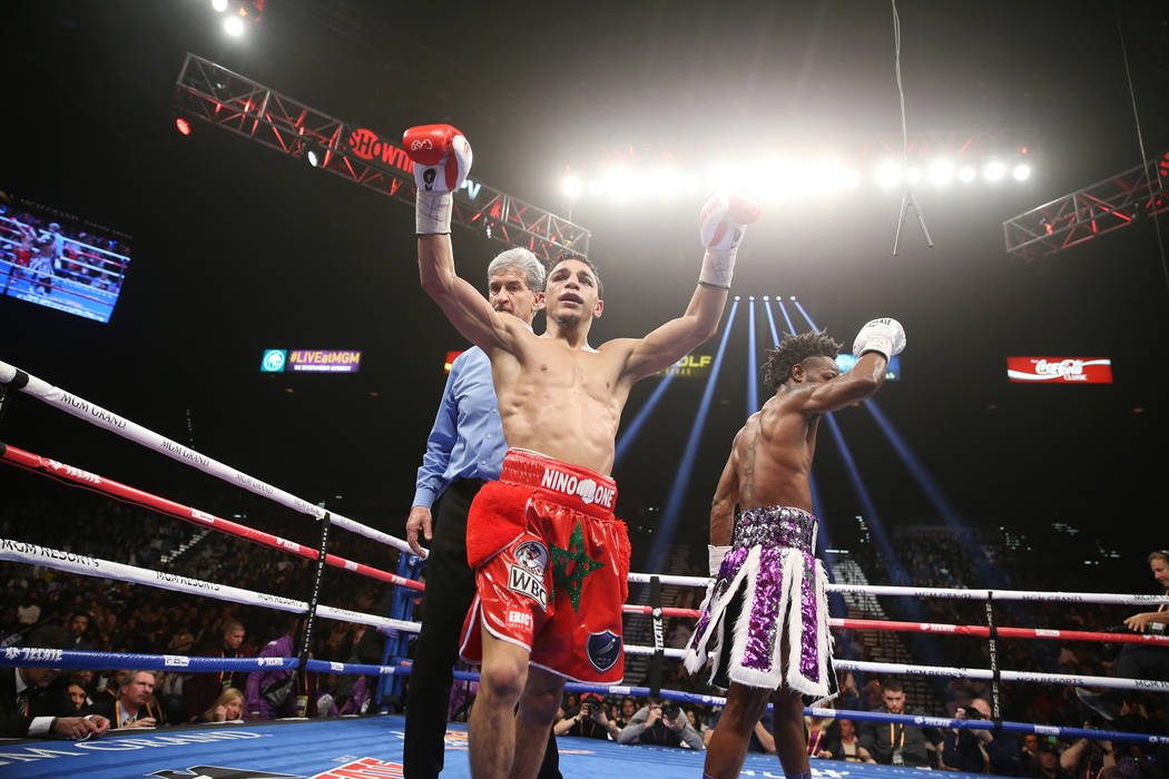 Nordine Oubaali raises his hands at the end of the fight against Rau'shee Warren in the WBC Bantamweight title bout at the MGM Grand Garden Arena in , Saturday, Jan. 19, 2019. (Erik Verduzco/Las V ...