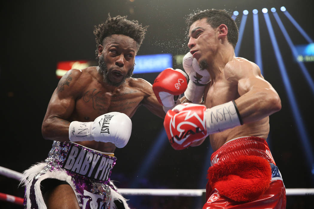 Rau'shee Warren connects a punch against Nordine Oubaali in the WBC Bantamweight title bout at the MGM Grand Garden Arena in , Saturday, Jan. 19, 2019. (Erik Verduzco/Las Vegas Review-Journal) @Er ...