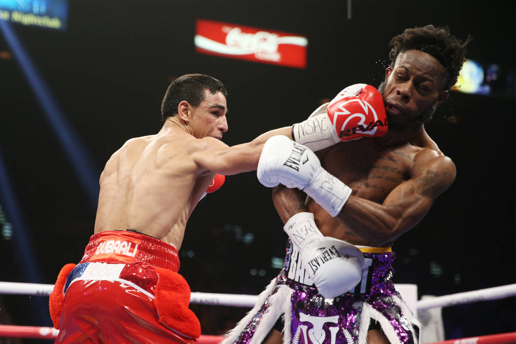 Nordine Oubaali connects a punch against Rau'shee Warren in the WBC Bantamweight title bout at the MGM Grand Garden Arena in , Saturday, Jan. 19, 2019. (Erik Verduzco/Las Vegas Review-Journal) @Er ...