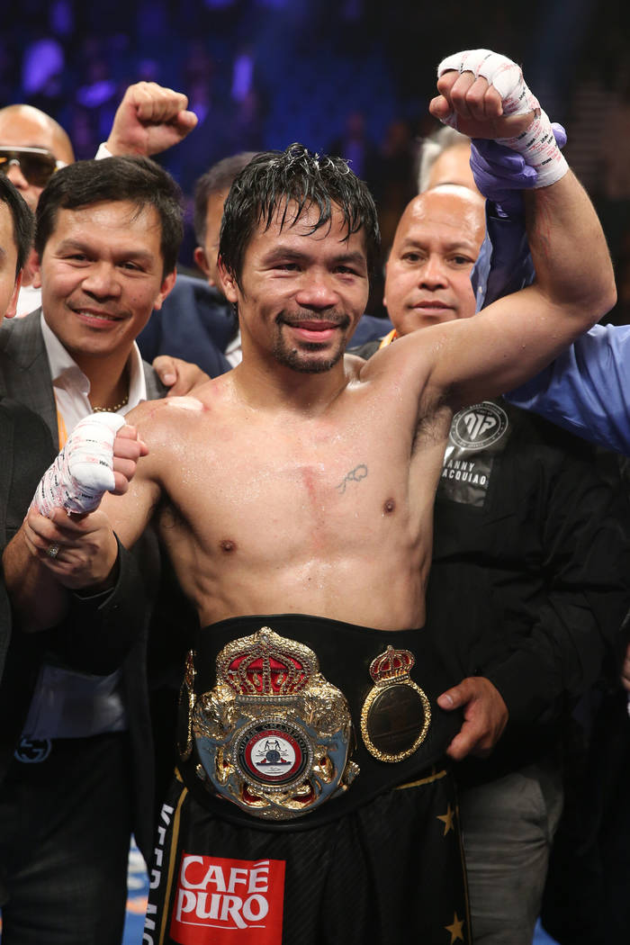 Manny Pacquiao celebrates his win unanimous decision win against Adrien Broner in the WBA Welterweight title bout at the MGM Grand Garden Arena in Las Vegas, Saturday, Jan. 19, 2019. (Erik Verduzc ...