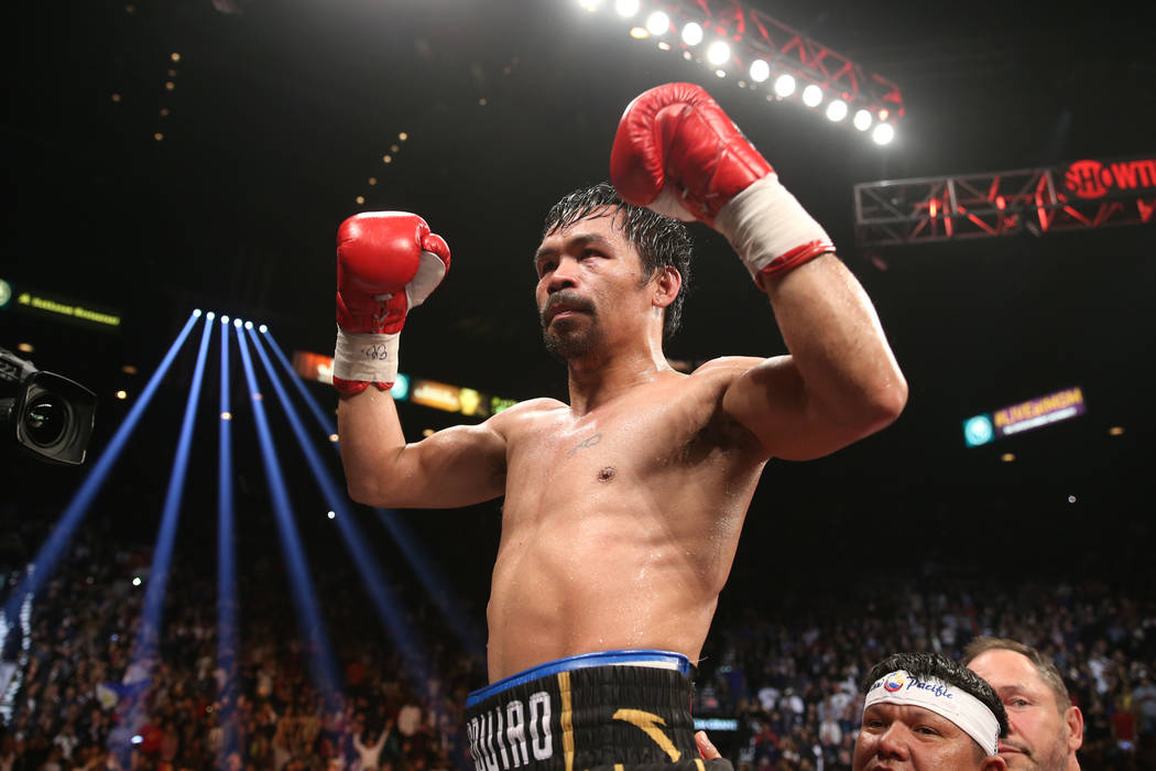Manny Pacquiao reacts after his fight against Adrien Broner in the WBA Welterweight title bout at the MGM Grand Garden Arena in Las Vegas, Saturday, Jan. 19, 2019. Pacquiao won by unanimous decisi ...