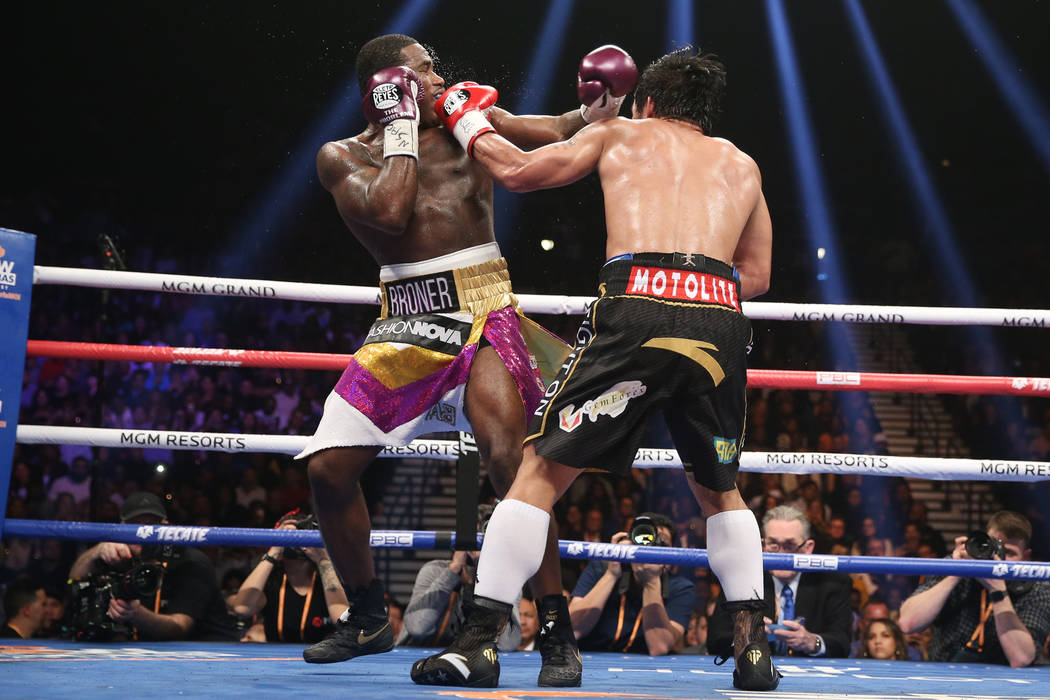 Manny Pacquiao, right, connects a punch against Adrien Broner in the WBA Welterweight title bout at the MGM Grand Garden Arena in Las Vegas, Saturday, Jan. 19, 2019. Pacquiao won by unanimous deci ...