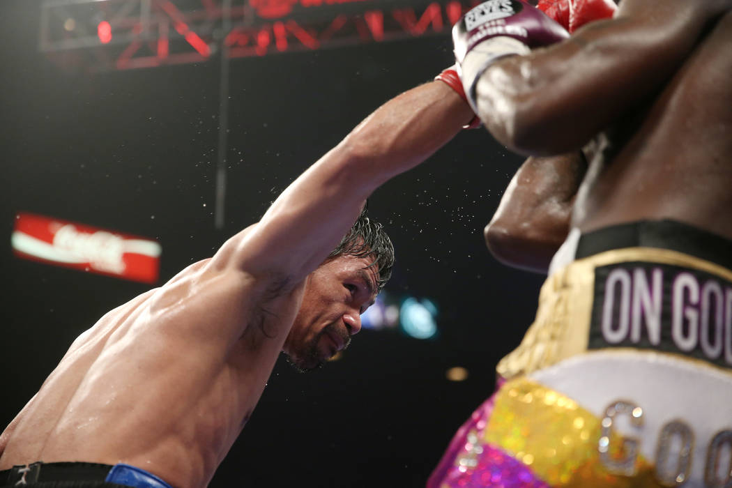 Manny Pacquiao, left, throws a punch against Adrien Broner in the WBA Welterweight title bout at the MGM Grand Garden Arena in Las Vegas, Saturday, Jan. 19, 2019. Pacquiao won by unanimous decisio ...