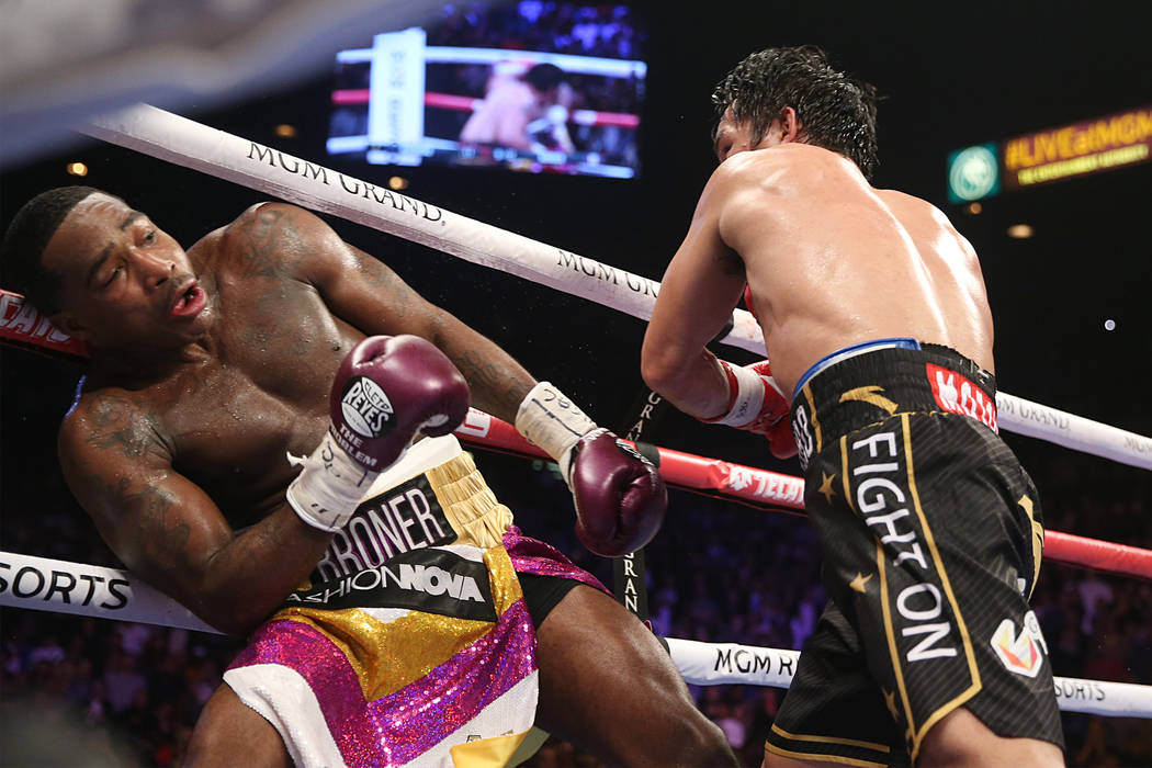Adrien Broner, left, moves away from a punch from Manny Pacquiao in the WBA Welterweight title bout at the MGM Grand Garden Arena in Las Vegas, Saturday, Jan. 19, 2019. Pacquiao won by unanimous d ...