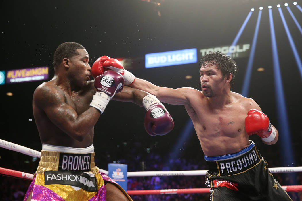 Manny Pacquiao, right, throws a punch against Adrien Broner in the WBA Welterweight title bout at the MGM Grand Garden Arena in Las Vegas, Saturday, Jan. 19, 2019. Pacquiao won by unanimous decisi ...