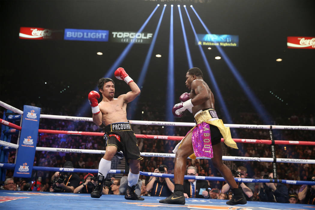 Manny Pacquiao, left, moves away from a punch from Adrien Broner in the WBA Welterweight title bout at the MGM Grand Garden Arena in Las Vegas, Saturday, Jan. 19, 2019. Pacquiao won by unanimous d ...