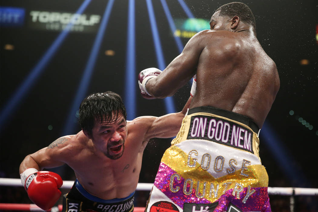 Manny Pacquiao, left, battles Adrien Broner in the WBA Welterweight title bout at the MGM Grand Garden Arena in Las Vegas, Saturday, Jan. 19, 2019. Pacquiao won by unanimous decision. (Erik Verduz ...