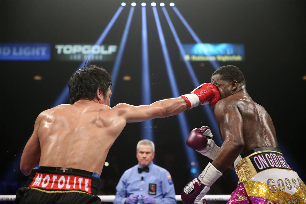 Manny Pacquiao, left, connects a punch against Adrien Broner in the WBA Welterweight title bout at the MGM Grand Garden Arena in Las Vegas, Saturday, Jan. 19, 2019. Pacquiao won by unanimous decis ...