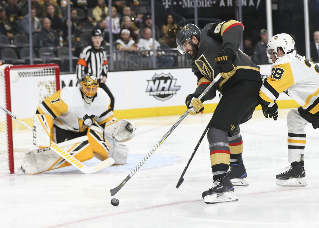 Golden Knights right wing Alex Tuch (89) looks to shoot against Pittsburgh Penguins goaltender Casey DeSmith (1) during the third period of an NHL hockey game at T-Mobile Arena in Las Vegas on Sat ...