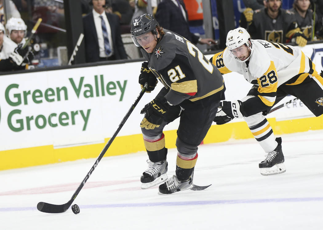 Golden Knights center Cody Eakin (21) moves the puck past Pittsburgh Penguins defenseman Marcus Pettersson (28) during the third period of an NHL hockey game at T-Mobile Arena in Las Vegas on Satu ...