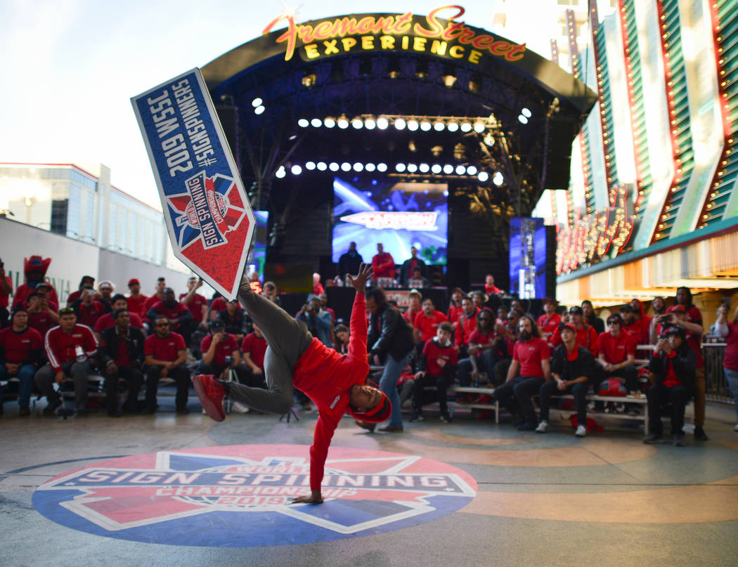 Rico El-Lis, from Los Angeles, competes in the Trick of the Year competition at the 2019 Sign Spinning World Championship at the Fremont Street Experience in Las Vegas on Saturday, Jan. 19, 2019. ...
