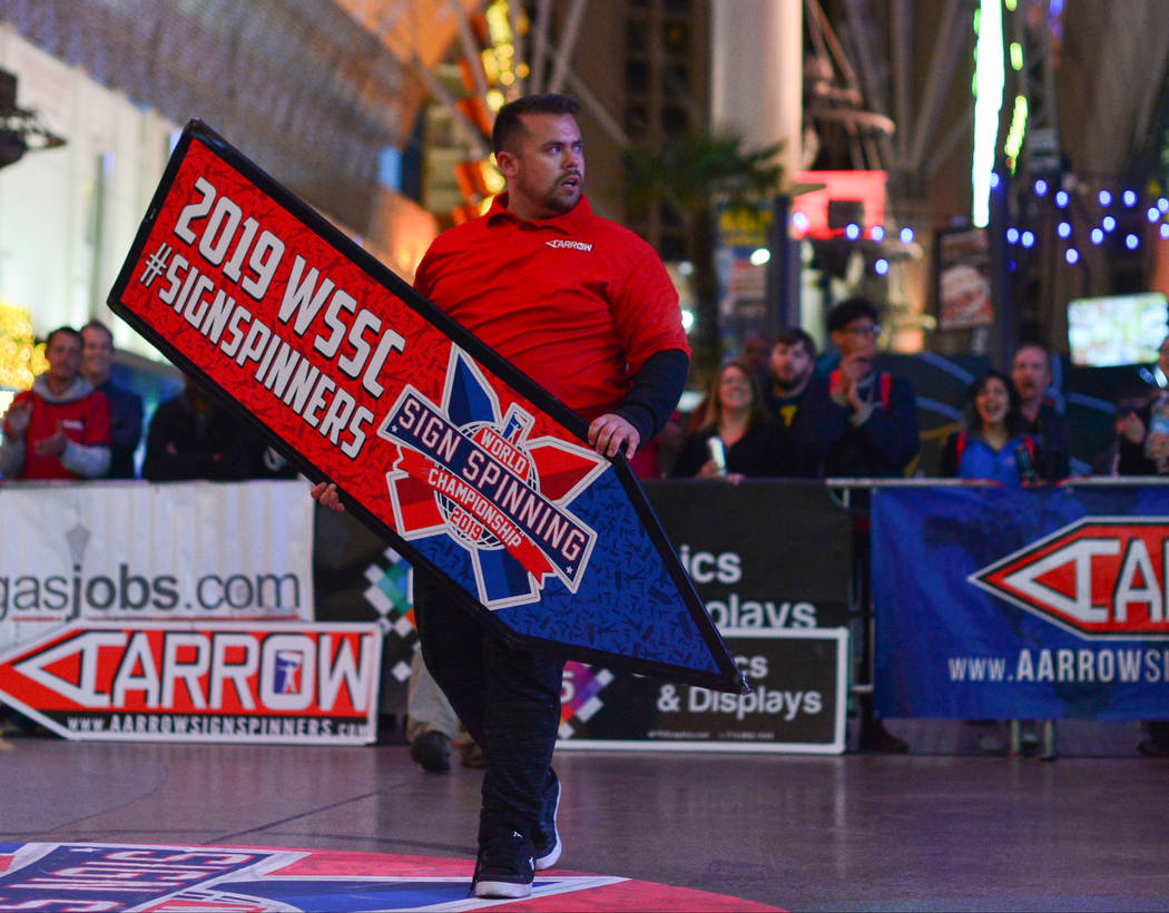 Matthew Doolan of Fort Worth, Texas, steps up to compete in the final round of the 2019 Sign Spinning World Championship held at the Fremont Street Experience in Las Vegas on Saturday, Jan. 19, 20 ...