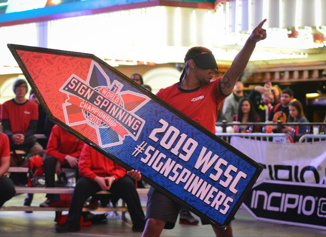 Davis Davis from San Diego, who placed eighth, competes blindfolded in the final round of the 2019 Sign Spinning World Championship held at the Fremont Street Experience in Las Vegas on Saturday, ...