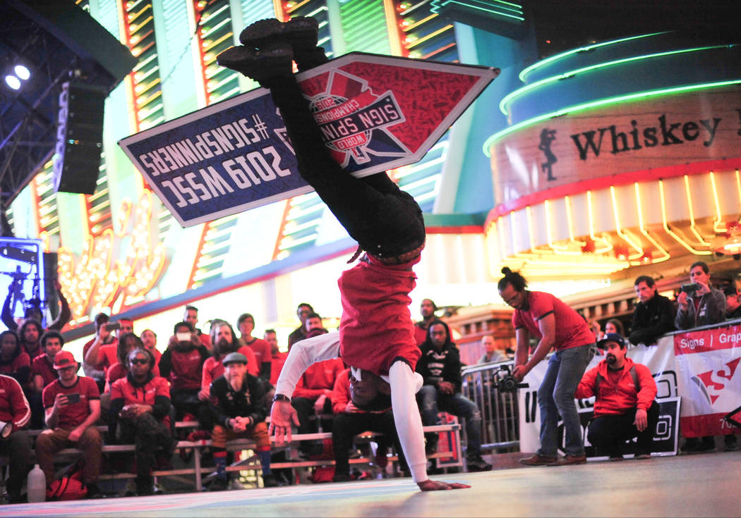 Ray Rivera, who placed second overall, competes in the final round of the 2019 Sign Spinning World Championship held at the Fremont Street Experience in Las Vegas on Saturday, Jan. 19, 2019. Brett ...