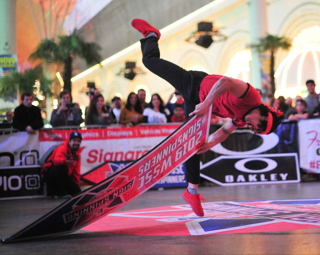 Jose Angeles from Northern California, who placed fifth, competes in the final round of the 2019 Sign Spinning World Championship held at the Fremont Street Experience in Las Vegas on Saturday, Ja ...